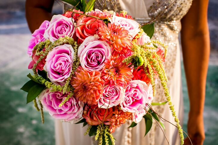 The bride's bouquet was an arrangement of orange dahlia and a pink and orange roses mix accented with moss.