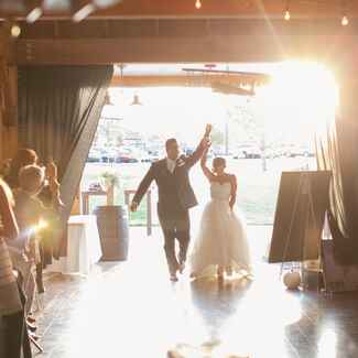 Bride and groom entrance at barn wedding reception