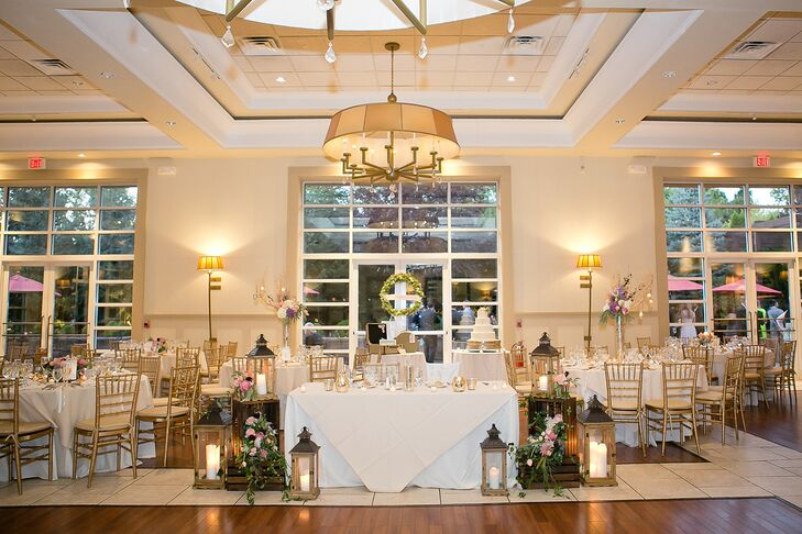 The same arrangements of lanterns and crates that flanked both sides of the aisle were brought inside to frame the sweetheart table during the reception. Mary arranged the wreath behind the table.
