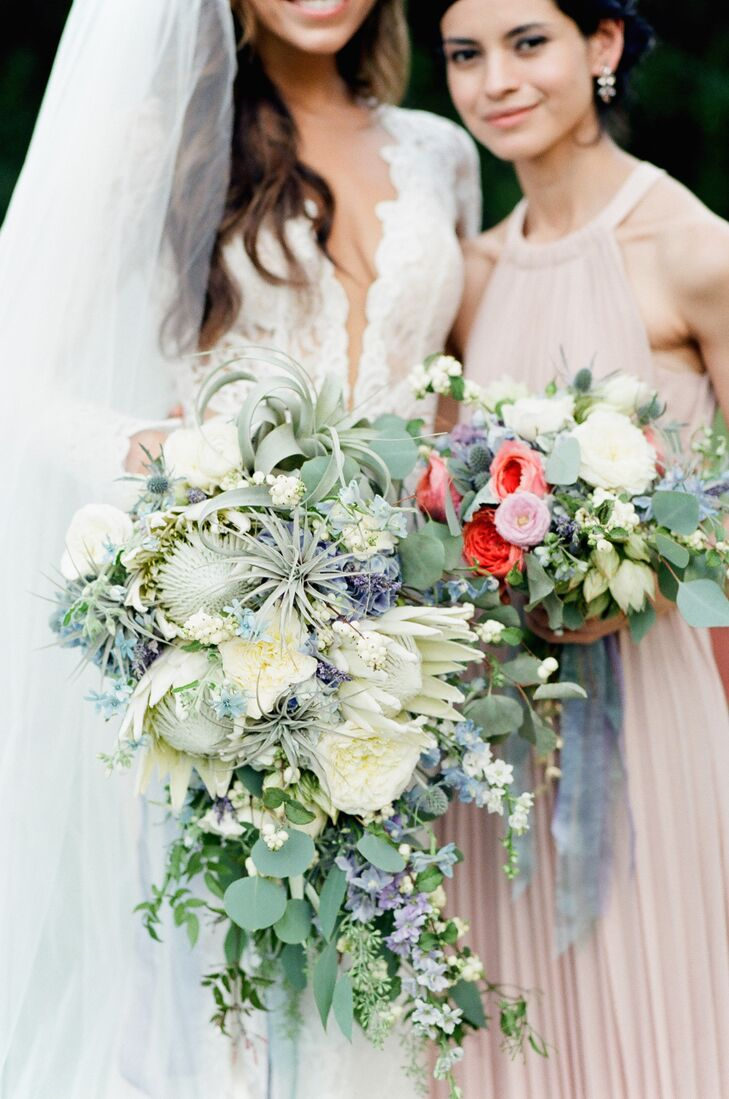 Fionna Floral took the reins on all of the couple's floral needs, designing striking, textured arrangements of veronica, hydrangeas, tillandsia, garden roses, tulips, amaranthus, dusty miller, eucalyptus, air plants and more for Sylvia and her bridesmaids to carry down the aisle. The bouquets perfectly captured Sylvia and Daniel's California theme, filled with soft shades of blue, green, ivory and pink.