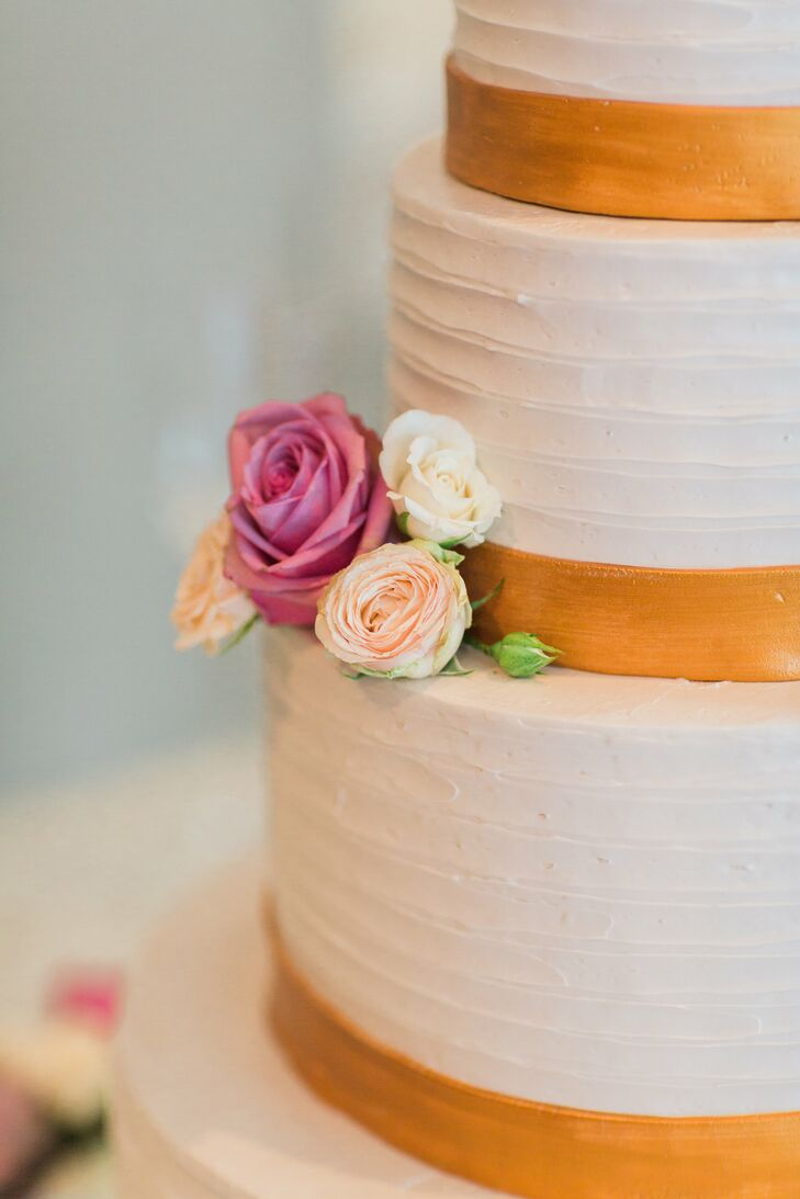 """I certainly didn't want ours to be a forgettable cake,"" Tara says of the orange and white confection. Flavors included a yellow cake tier filled with strawberry and white chocolate and a matcha almond cake for more adventurous guests."
