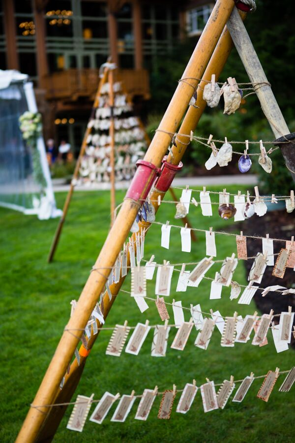 """Our escort cards attached to clothespins hung from a teepee-like structure made of old wooden rowboat oars, faded by years of use in the sun and saltwater along Hood Canal,"" Michelle says. ""These oars came directly from my husband's family beach house. The design and execution were left to some of the more crafty members of our extended family."""