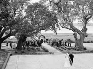 Black and white photo of bride walking to altar