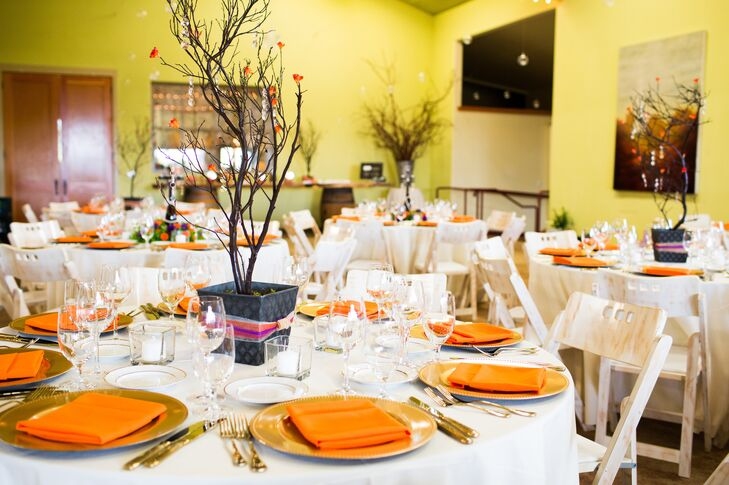 Centerpieces of branches with tiny orange flowers budding decorated the tables set with gold dinnerware and orange napkins.