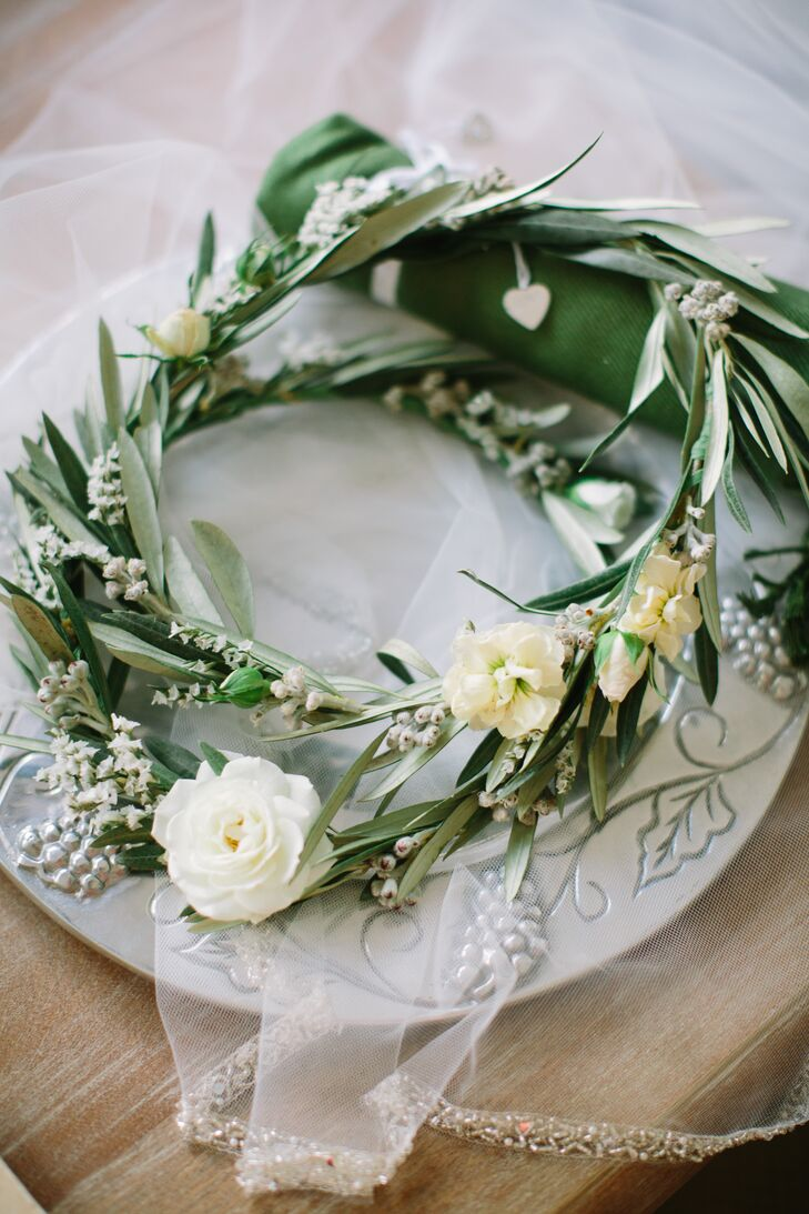 During the reception, Sloane wore an olive branch and rose floral crown in her half-up hairstyle.
