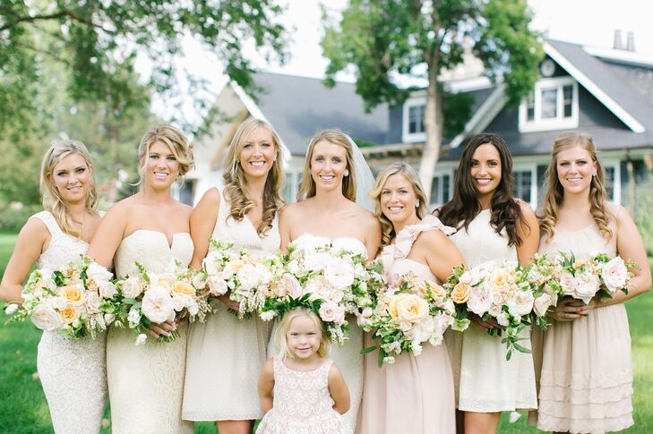 "The bridesmaids chose their own dresses for the garden party wedding. Bryn told them she wanted the dresses to be short and champagne or beige. ""I really wanted a neutral color because I didn't want anything clashing with the natural colors from the lake and scenery,"" Bryn says."