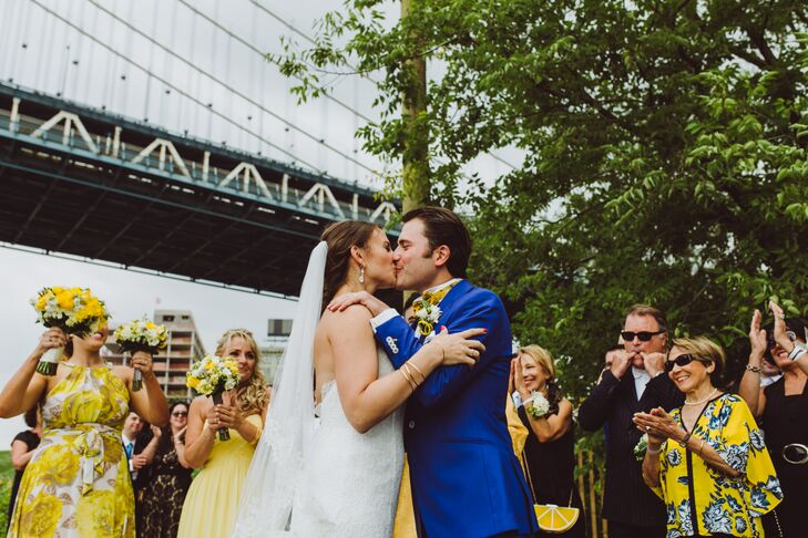 "The couple gathered their family and friends at Pebble Beach in Brooklyn Bridge Park for an intimate ceremony with direct views of the Manhattan skyline. ""Having a wedding in a public park was challenging, but we pulled it off,"" Candice says. ""No flowers were necessary, which was a huge budget saver.''"