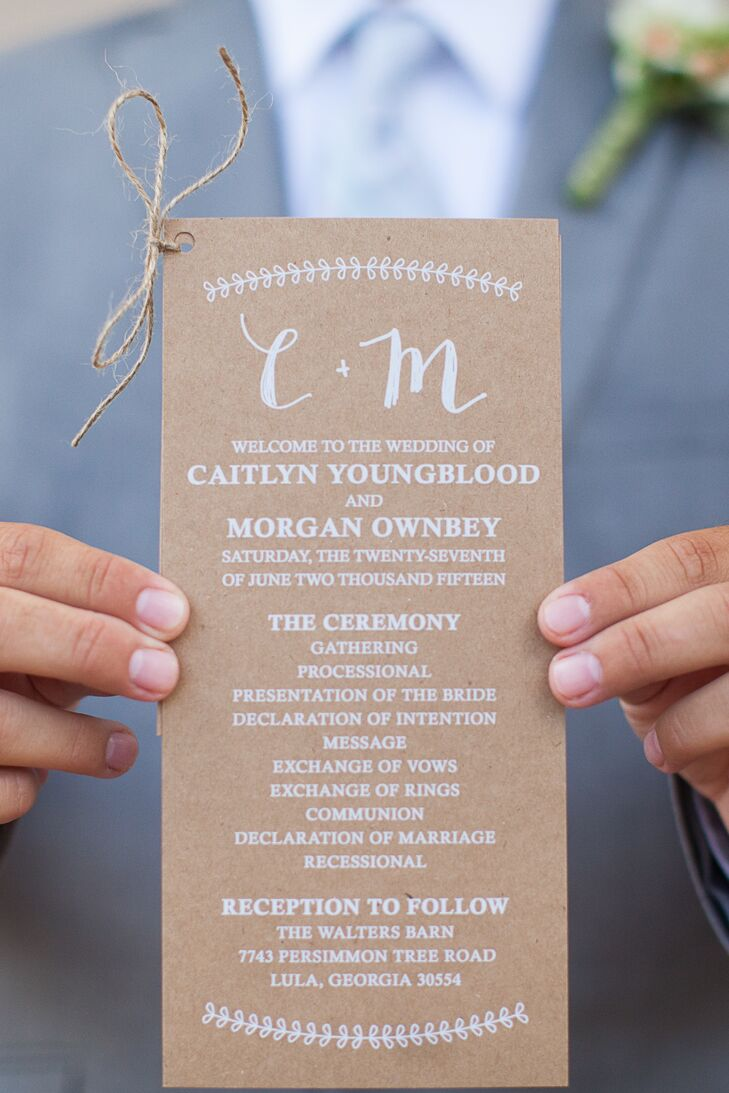 Caitlyn and Morgan wanted their stationery to look rustic. For their ceremony programs, they went with kraft paper with white script and a hemp tie.