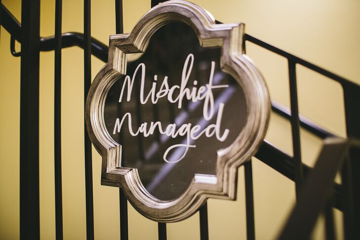 """There were a lot of mirrors with writing scattered around our venue, which definitely gave it a Hogwarts Castle vibe —we even got to keep one that said 'Mischief Managed,'"" Jordan says."