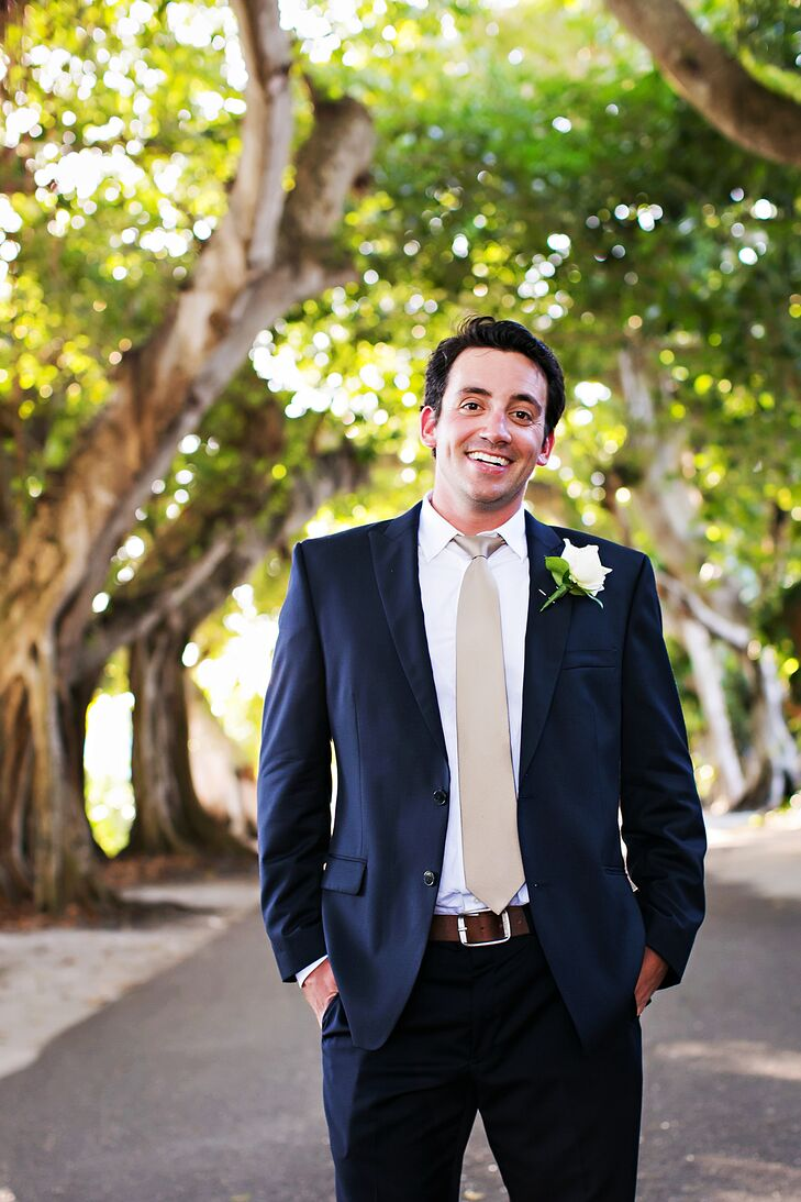 Navy Blue Groom\'s Suit and Champagne Tie