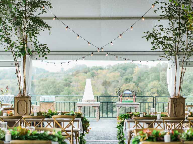 White buttercream four-tier wedding cake in an outdoor venue