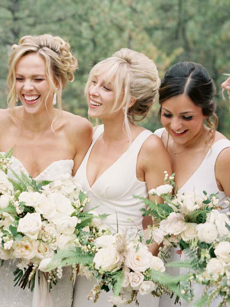 Boho bridesmaid hairstyle with a messy bun and bangs