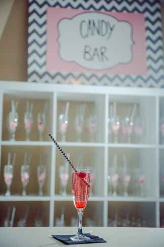 Pink signature cocktail with cotton candy