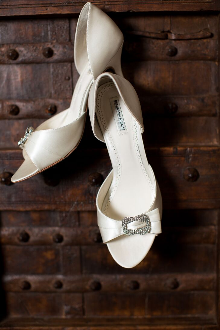The bride wore ivory open-toed Benjamin Adams pumps on her wedding day.