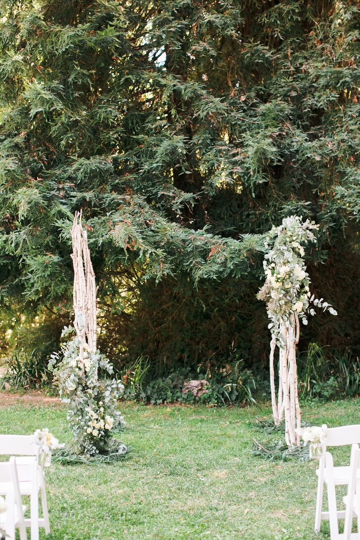 Deborah and Jared got married at the wedding arch made of branches and draped with greenery, set up outside at Dawn Ranch Lodge in Guerneville, California. The arch blended in well with the surrounding environment, bringing a natural feel to life.