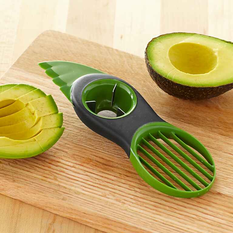 Avocado slicing tool with fan lade and pit remover