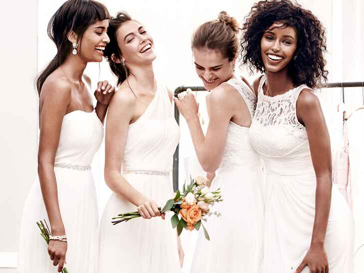 four bridesmaids in different ivory bridesmaid dresses