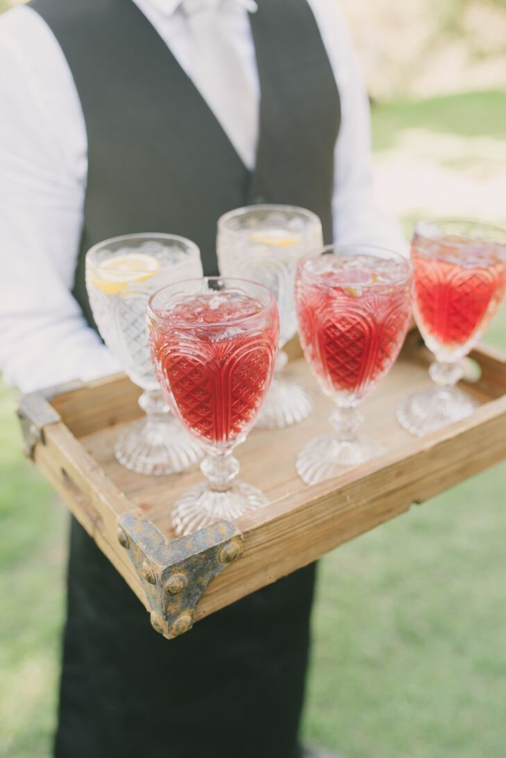 After the ceremony, guests were served one of two signature cocktails from wooden barn-wood box trays: a Manhattan for Kevin and a cucumber and mint vodka soda for Rory.