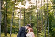Whitney and Adam highlighted the character of their mountain venue with earthy colors and rustic details. Deep purples, silvery greens and touches of