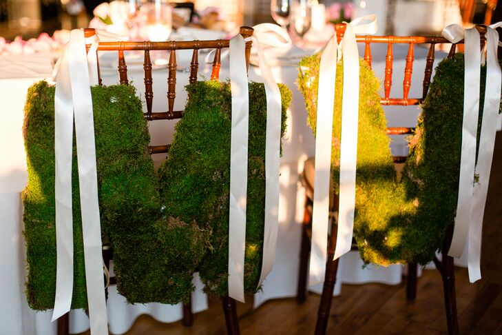 Victoria and Matthew repurposed the large moss letters that hung from the church doors as chair decorations during their evening reception.