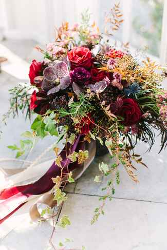 Jewel-toned purple and maroon fall wedding bouquet