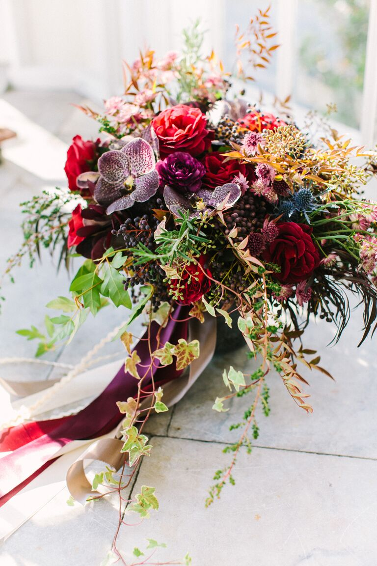 15 fall wedding bouquet ideas and which flowers theyre made with jewel toned purple and maroon fall wedding bouquet junglespirit