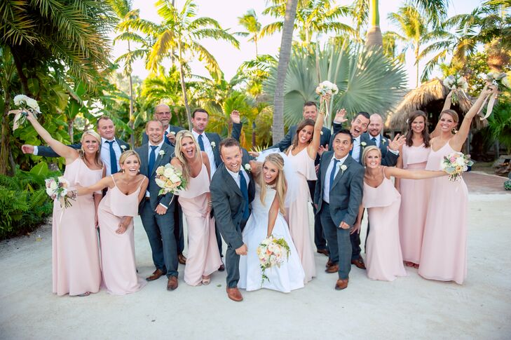 Sarah's 'maids wore floor length blush dresses from Joanna August, while the groomsmen wore sharp gray suits with matching carmel brown leather shoes.