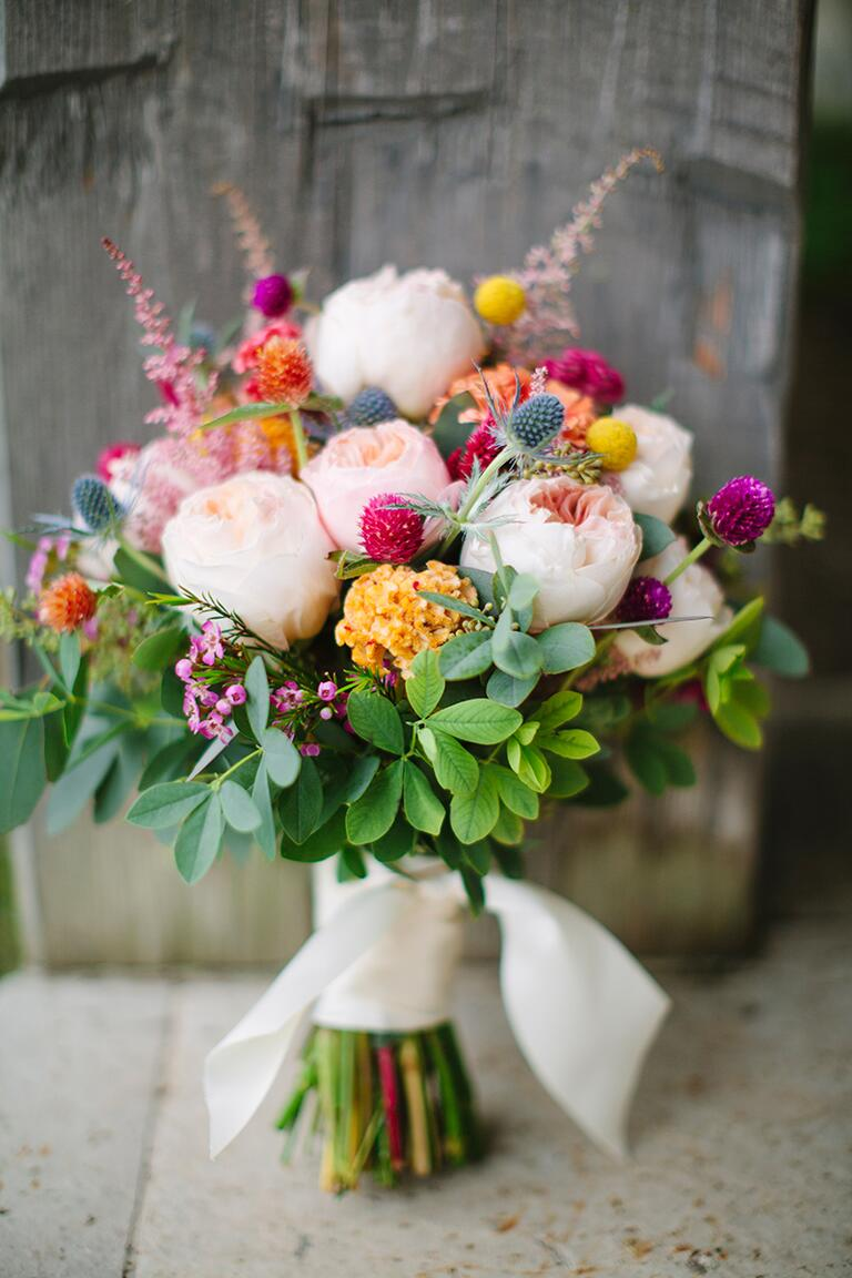 Bright fall wedding bouquet with garden roses, thistle and red clovers