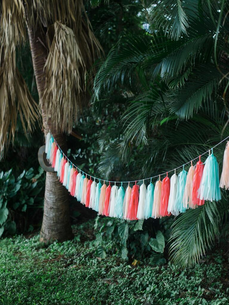 Light blue and coral colored wedding tassel decorations