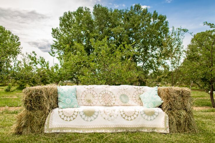 Leslie and Andrew had a small fire pit with hay bales set around it. Each bale had various quilts on top for a comfortable, casual look. They also constructed a hay-bale couch, with throw pillows and a large quilt over the top. Guests loved hanging out on it throughout the night.