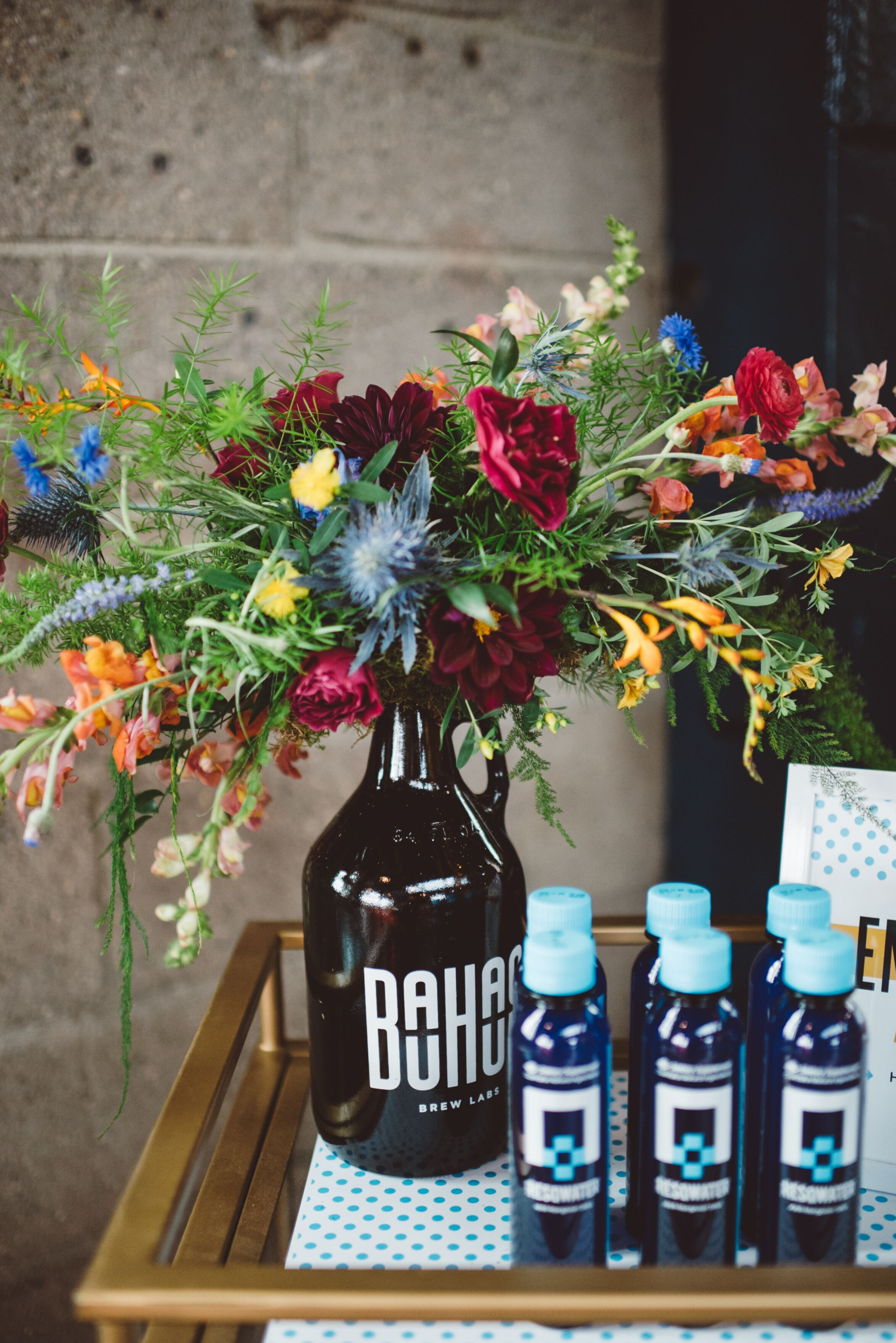 wildflower arrangements in beer growlers