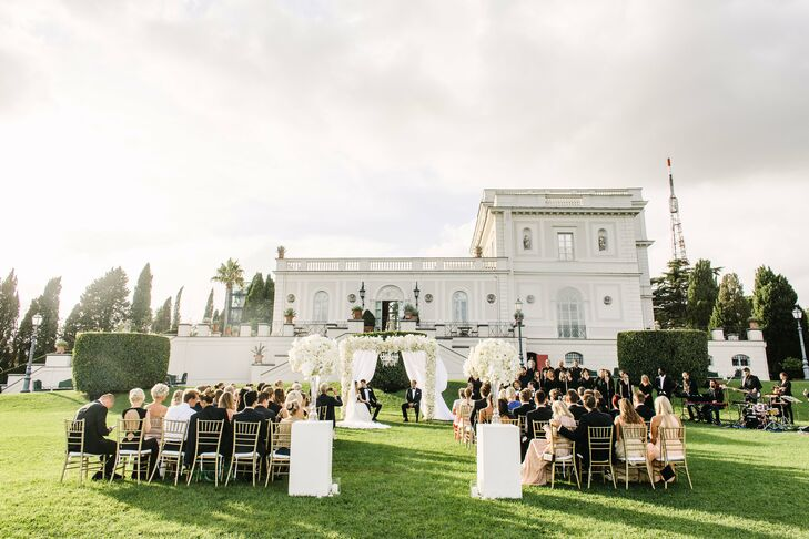 "The ceremony unfolded outdoors in Villa Miani's beautifully manicured English garden. ""We have always wanted a ceremony outside, and this spot fit us perfectly,"" Silje says. ""To complement the gorgeous white villa, we wanted all the flowers to be white and the rest of the decor to be gold."""