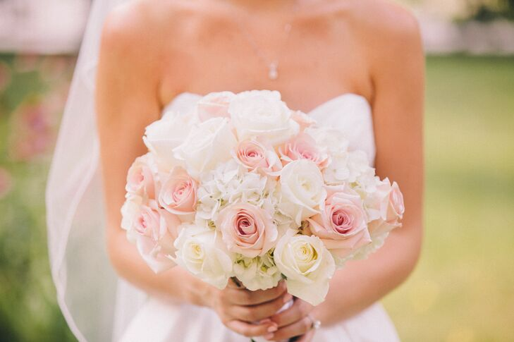 Keeping with Allison and Addison's pink and white color palette, the bride carried a bouquet of pink and white roses.