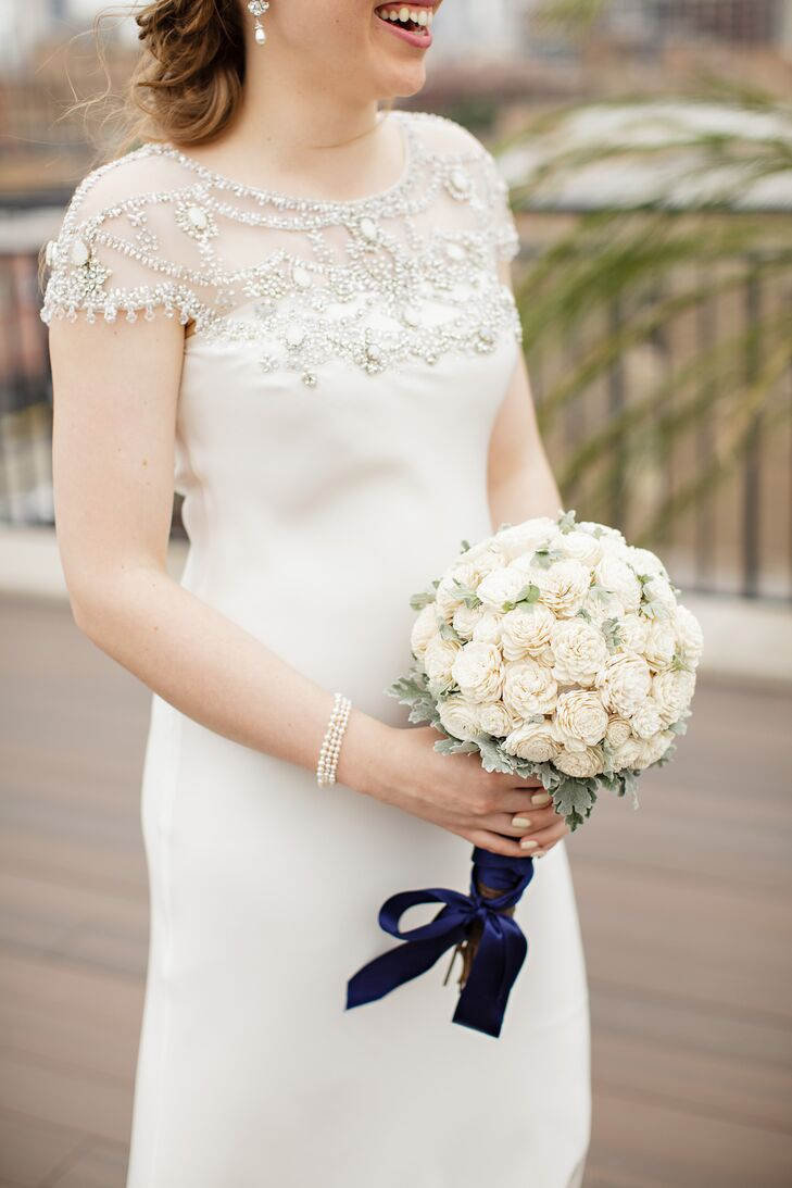 Rachel's wedding dress was a perfect reflection of her conservative and feminine style. The pearl, crystal and blue opal beading across the sheer bateau neckline on the silk ivory dress was simply beautiful. What's more, her bouquet consisted of balsa-wood flowers.