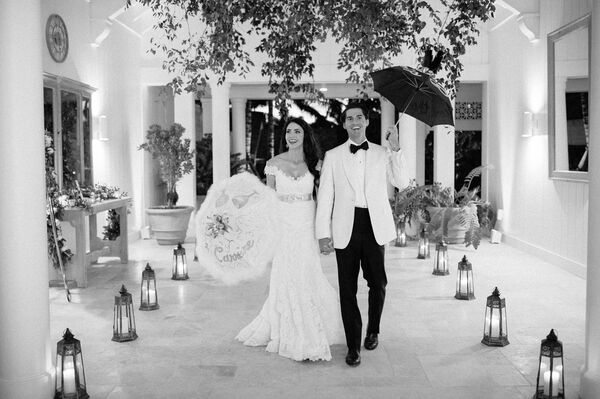 Couple Make Traditional Exit with Umbrellas at the Jupiter Island Club in Hobe Sound, Florida