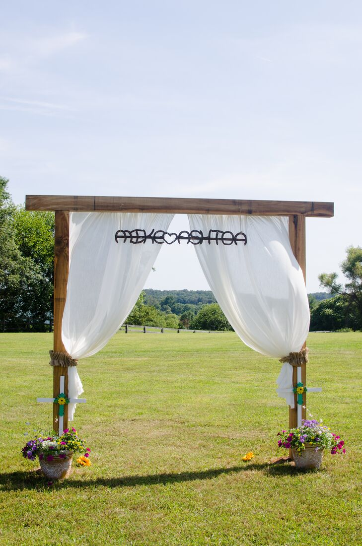 Wooden Wedding Arch With Billowing Drapes