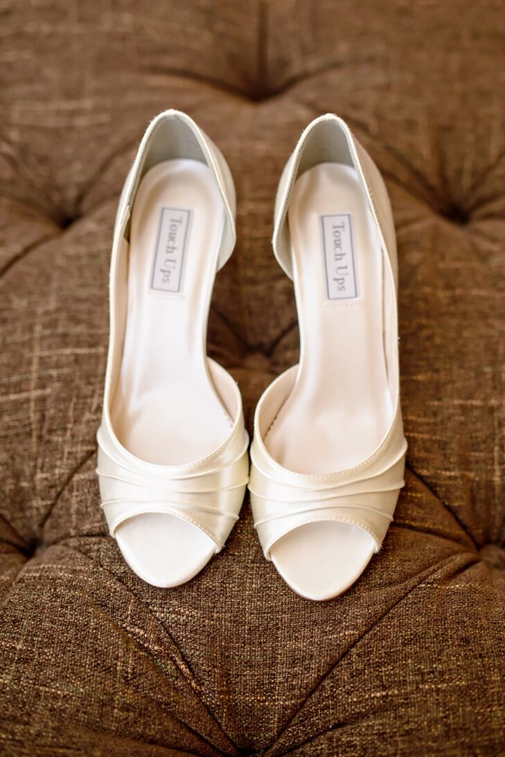 Stephanie walked down the aisle in a pair of elegant satin peep-toe heels in a soft shade of ivory.