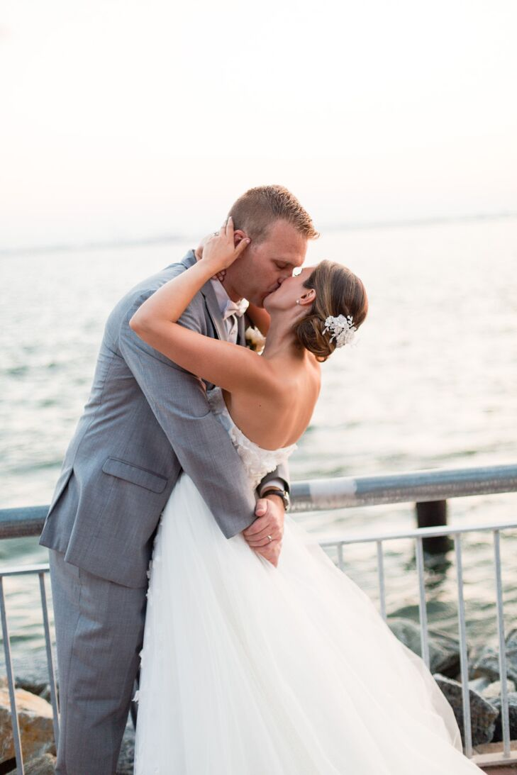 Bride and Groom Kiss at Waterfront
