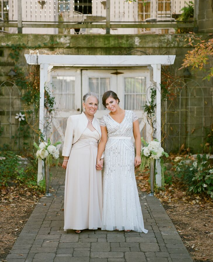"The bride took the nontraditional route when it came to her wedding procession. ""Both of my parents walked me down the aisle,"" Christiana explains. ""I know it's tradition for the father of the bride to walk her down the aisle, but I wanted to have my mom be a part of it as well."""