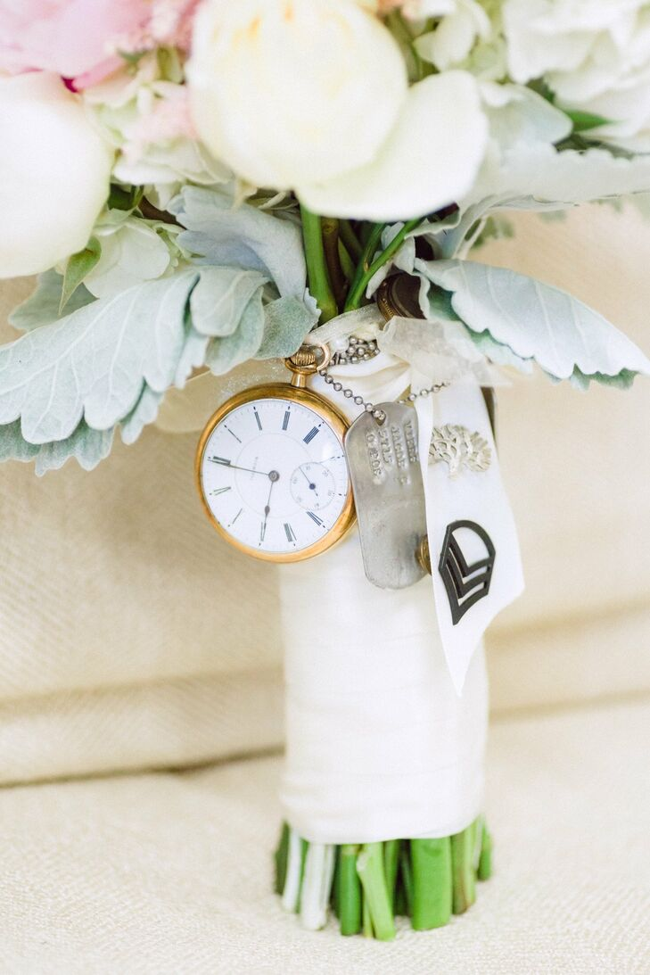 Amanda's bouquet wrap was pinned with a number of family heirlooms, including a pocket watch and dog tags.