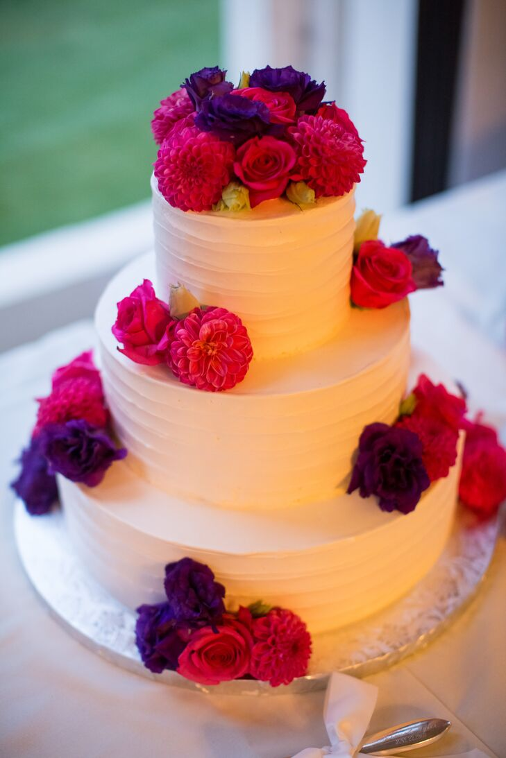 wedding cakes with pink and purple flowers bright pink and purple flowers on ivory wedding cake 26083