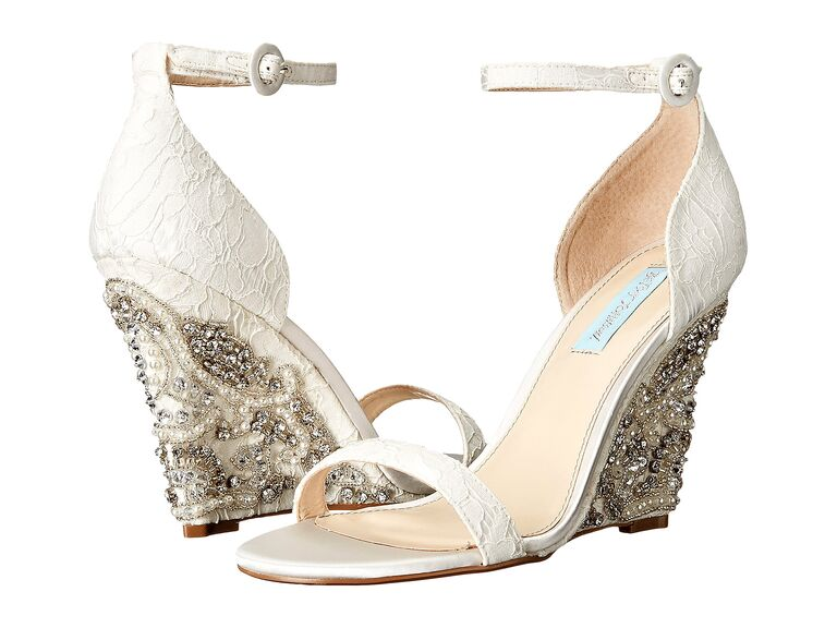 Use The Knot's round-up of comfortable wedding wedges in all bridal colors you can buy right now.
