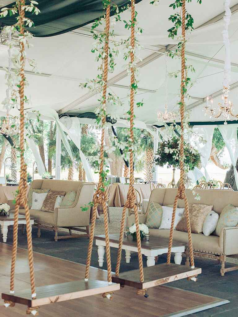 Whimsical swings for an outdoor wedding tent