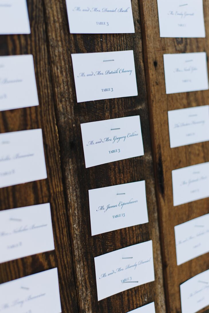 Rather than display their escort cards on a table, the couple opted to nail them to a large, wooden wall for guests to find their seats with ease.