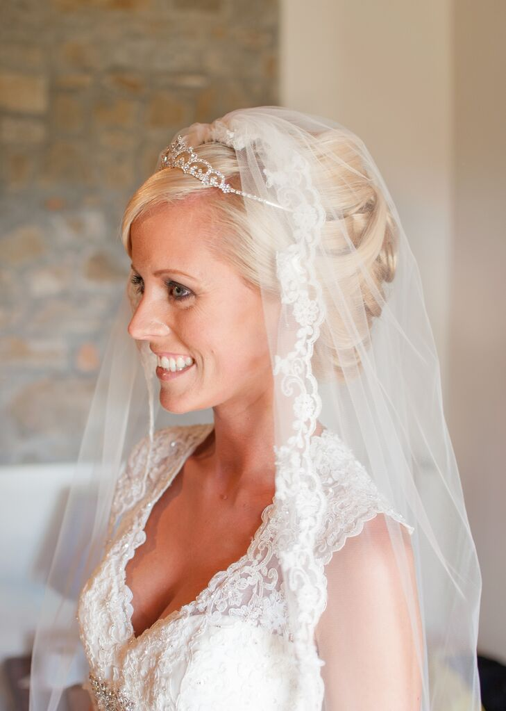 The bride wore a veil with an elegant lace trimming and underneath had a tiara placed into her undo hairstyle.