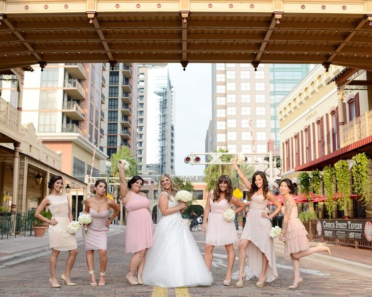 The bridesmaids wore blush pink dresses in their own style.