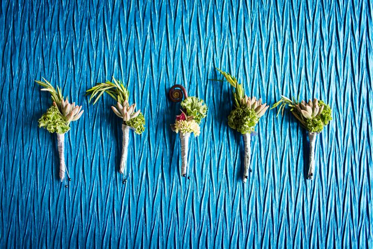 Brandon and the groomsmen wore rustic boutonnieres including succulents, cabbage and rosemary on their lapels. Brandon also had a fiddlehead fern to stand out from the other men.