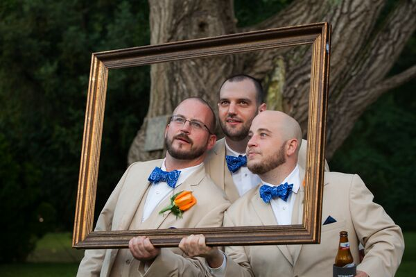 Groomsmen in Khaki Suits and Blue Bow Ties