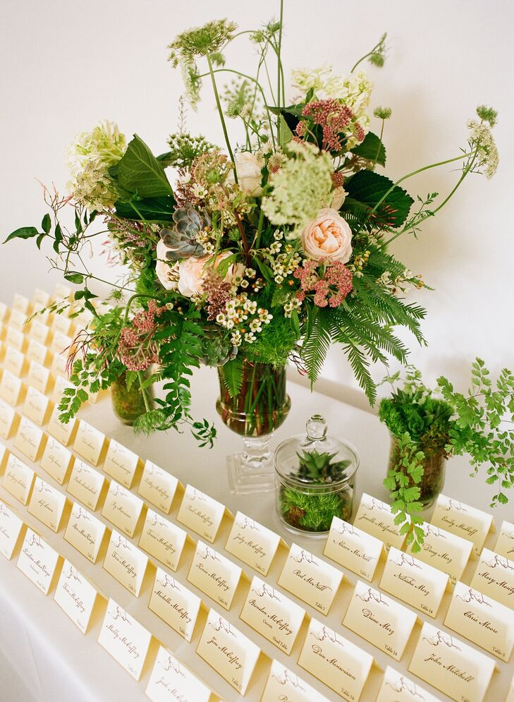 Epitome Papers created all the stationery, including the matching invitations and escort cards. They were printed on ivory paper with branchy brown typography. The table was decorated with textured florals created by Martha's Gardens, plus terrariums filled with succulents and moss.