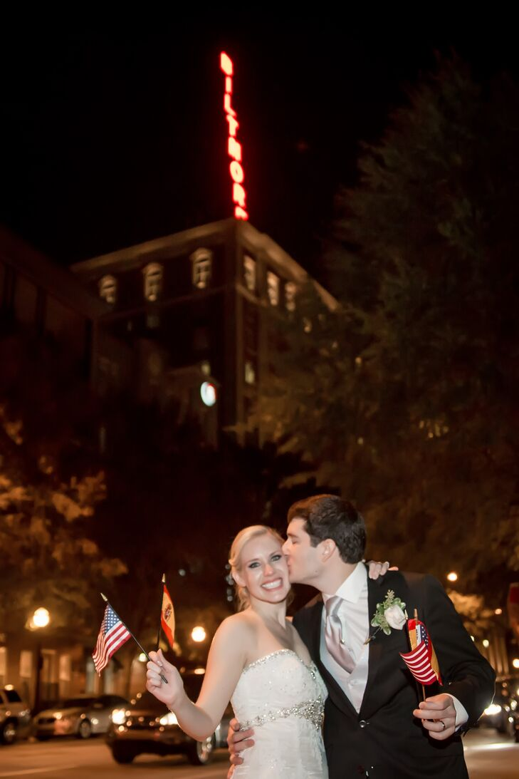 Kelly and Jonatan waved Spanish and American flags as they made their grand exit from the Biltmore Ballrooms in Atlanta, Georgia.